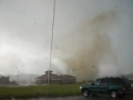 VIDEO: Man Casually Chats With Sister on Phone as Tornado Whizzes By