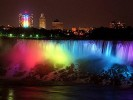 Niagara Falls lit up like a rainbow.