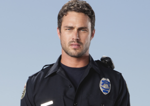 """Taylor already played an EMT in the short lived series """"Trauma"""" so we know he looks good in a uniform."""