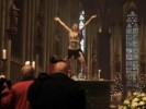 PHOTO: Woman climbs shirtless on top of altar at Germany's largest cathedral on Christmas morning.