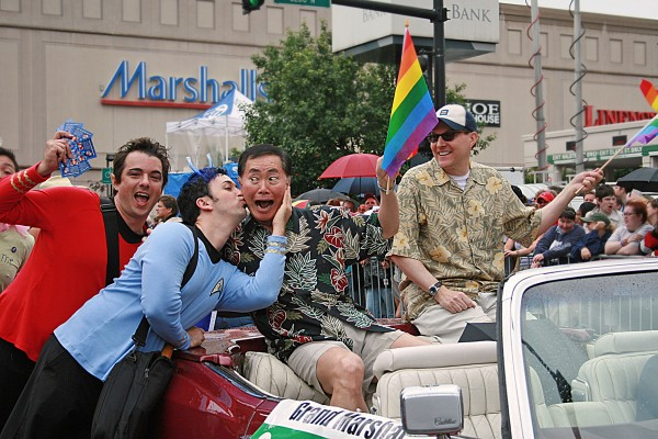 Marc and Fausto in Star Trek uniforms kissing George Takei and his partner Brad at Pride in Chicago, June 25, 2006. Photo: Wendy Malley.